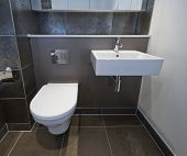 closeup of a toilet and sink of a modern bathroom