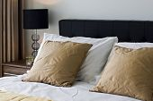 contemporary double bed detail with luxury accessory