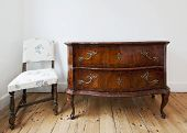 beautiful antique chest of drawers with curly brass handles