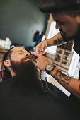 Man Having A Shave At The Barber Shop poster
