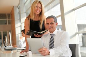 foto of blonde woman  - Manager and assistant working in the office - JPG