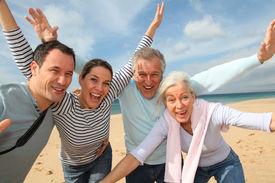stock photo of family vacations  - Family vacation at the beach - JPG