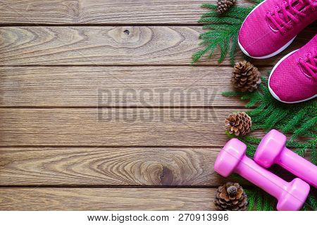 poster of Fitness And Healthy Christmas Sport Composition. Flat Lay Of Sport Shoes, Dumbbells Pine Leaves And