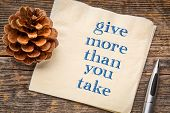Give more than you take - inspirational handwriting on a napkin with a season decoration poster