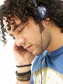 Young man listening music using headphones.