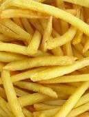 stock photo of pommes de terre frites  - French fries potatoes full frame vertical - JPG
