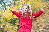 Comfortable And Carefree. Child Blonde Long Hair Walking In Warm Jacket Outdoor. Girl Happy In Red C poster
