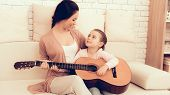Kids Home Games. Rest At Home. Child Development. Mom And Daughter Play. Playing Guitar At Home. Wom poster