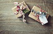 Christmas presents wrapped in brown paper on wooden background. Flatlay. Copy space poster