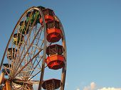 stock photo of candy cotton  - Ferris wheel spinning at the amusement park.