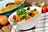 Close-up Of Fork And Tuna Risotto With Vegetables, Tomatoes, Broccoli And Parsley In The Bowl, Onion poster