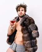 Richness And Luxury Concept. Guy Attractive Rich Posing Fur Coat On Naked Body. Rich Athlete Enjoy H poster