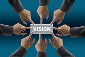 A diverse business team with hands together push vision button
