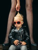 Forever Rocker. Rock And Roll Fashion Trend. Small Boy At Female Legs. Rock Style Child. Cute Little poster
