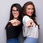 We Choose You. Smiling Business Women Pointing At Camera, Want You, Gray Studio Background poster