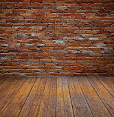 brick wall and wood floor