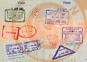 hong kong,china,malaysia,thailand and vietnam stamps on french passport with compass in backgrounds high definition scan