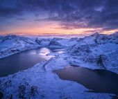 Aerial View Of Snowy Mountains, Sea, Colorful Cloudy Sky At Night In Lofoten Islands, Norway. Winter poster