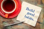 build good habits - inspirational handwriting on a napkin with a cup of tea poster
