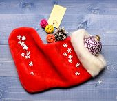 Christmas Sock Toned Wood Background Top View. Fill Sock With Gifts Or Presents. Celebrate Christmas poster