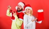 Check Contents Of Christmas Stocking Gift Received. Couple Cheerful Face Check Out Gift In Christmas poster