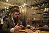 Bearded Man In Restaurant With Companion. Business On Go And Communication. Confident Bar Customer S poster