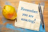 Remember - you are amazing! Inspirational handwriting on a napkin poster