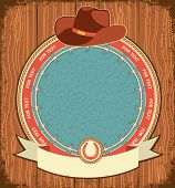 picture of leather tool  - Western label background with cowboy hat on old wood texture - JPG