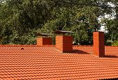 The Roof Is Covered With Red Tiles