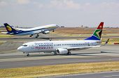 JOHANNESBURG - APRIL 18:Boeing 737 taxing after domestic flight on April 18, 2012 in Johannesburg, S