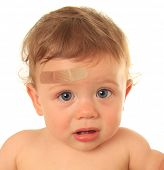 foto of scared baby  - Ten month old baby boy with band aid - JPG