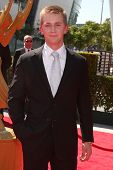 LOS ANGELES - SEP 15:  Jason Dolley arrives at the  Primetime Creative Emmys 2012 at Nokia Theater o