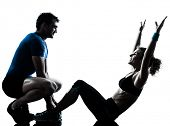 one caucasian couple man woman personal trainer coach exercising abdominal silhouette studio isolate