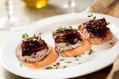 Canapes with chicken liver pate and onion chutney