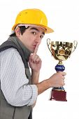 Secretive construction worker with a trophy