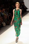 NEW YORK - SEPTEMBER 12: A model walks the runway at the NANETTE LEPORE Spring/Summer 2013 collectio