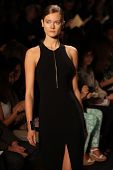 NEW YORK - SEPTEMBER 12: A model walks the runway at the MICHAEL KORS Spring/Summer 2013 collection
