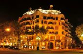 BARCELONA, SPAIN - SEPTEMBER 10: Casa Mila, or La Pedrera, at night on September 10, 2012 in Barcelona, Spain. This famous building, placed in Passeig de Gracia, was designed by Antoni Gaudi