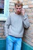 Young Stylish Man Talk On Mobile Phone.