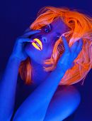 Uv light portrait, woman with glowing accessories and make up