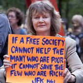 NEW YORK - SEPT 17: A protester holds a sign with a quote from JFK as she stands in Zuccotti Park on