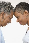 picture of forehead  - Close up profile of mother and daughter touching forehead - JPG
