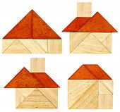 stock photo of tangram  - four abstract pictures of a house with a red roof built from seven tangram wooden pieces - JPG