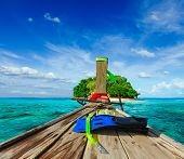 Vacation holidays adventure  concept background - tropical island and long-tail boat  with snorkelin
