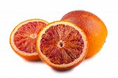 Whole And Two Halves Of Blood Red Oranges