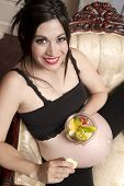 Pregnant Woman Expecting Baby Chair Eating Bowl Fresh Fruit