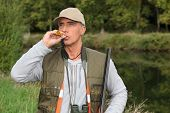 stock photo of cap gun  - portrait of a hunter - JPG