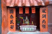 Small Chinese shrine and burning incense