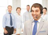 bright picture of friendly male helpline operator