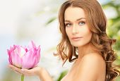 picture of lovely woman with lotos flower